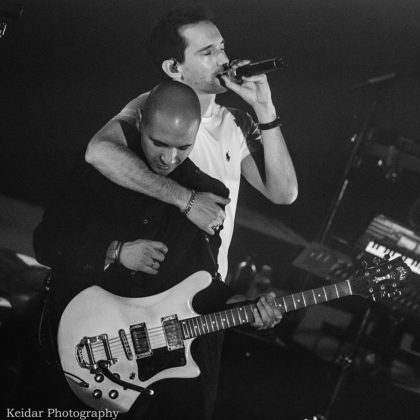 Picture of Ivri Lider in concert with photography by Omer Keidar