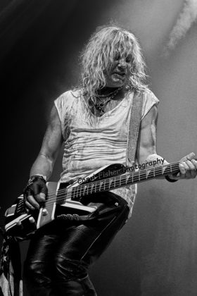 Picture of Def Leppard in concert with heavy metal music photography by Carol Fisher
