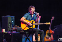 Picture of Ian Moss in concert with photography by Deb Kloeden