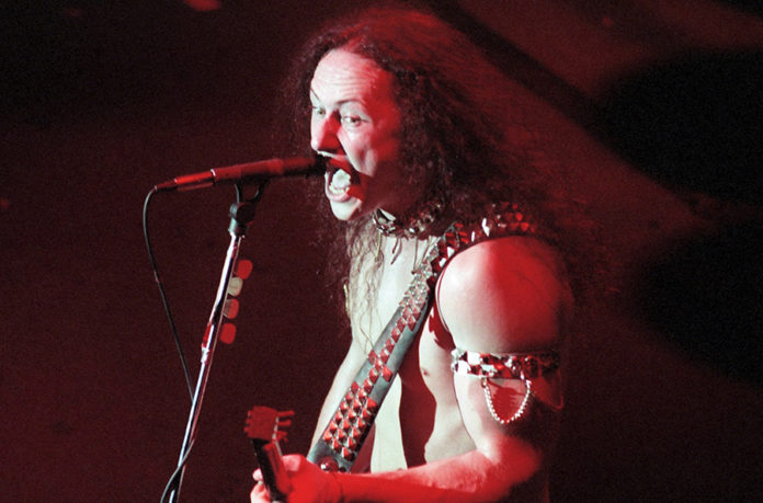 Picture of the black metal band Venom in concert taken in 1986 by Bill O'Leary