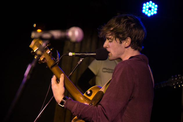 Picture of Garrett Goodman in concert with photography by Danni Fro