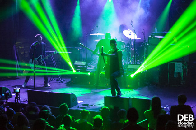 Picture of Sleepmakeswaves in concert by Australia music photographer Deb Kloeden