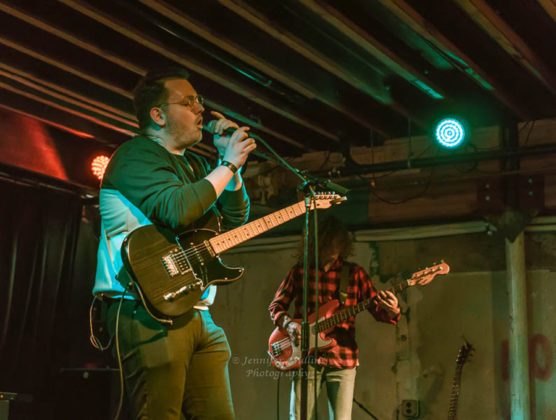 Picture of Alex Mullins in concert with photography by Jennifer Mullins