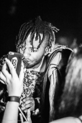 Picture of MadeinTYO in concert with photography by Kasper Pasinski