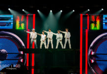 Picture of the pop group New Kids on the Block in concert with photography by Dee Carter