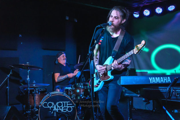 Picture of the indie rock band Coyote Tango in concert taken by Jennifer Mullins