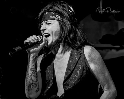 Picture of the rock band L.A. Guns in concert by Ruth Preston