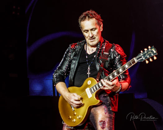 Picture of the heavy metal band Def Leppard in concert taken by Ruth Preston