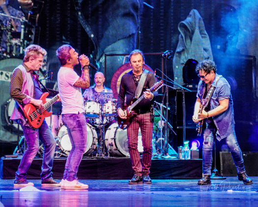 Picture of the rock band Journey in concert taken by Ruth Preston