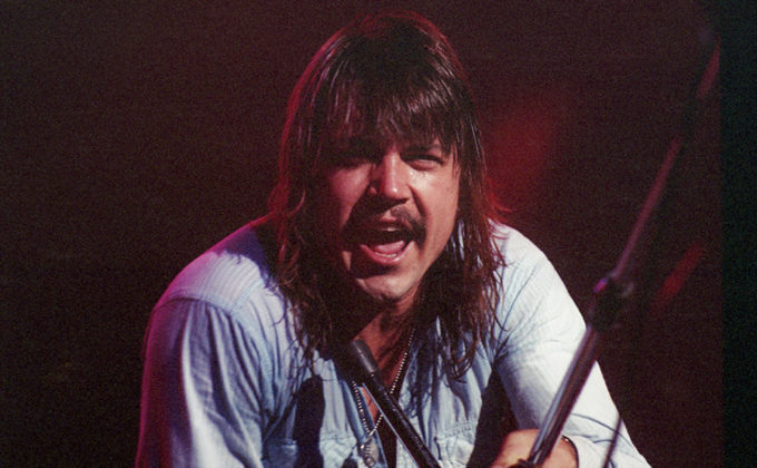 Picture of the rock band Molly Hatchet in concert in analog by Bill O'Leary
