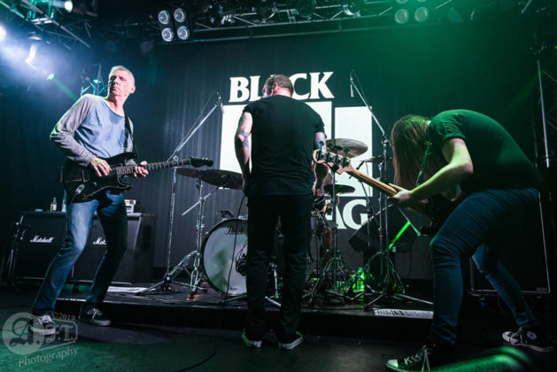 Picture of the punk band Black Flag in concert taken by Aki Fujita Taguchi