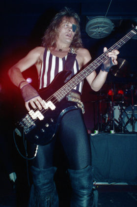 Picture of Timi Hansen with the heavy metal band King Diamond in concert taken by Bill O'Leary