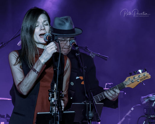 Picture of 10,000 Maniacs in concert taken by American music photographer Ruth Preston