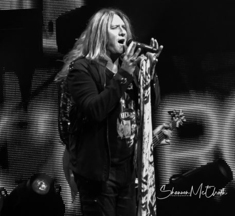 Picture of the rock group Def Leppard in concert taken by Shannon McElrath